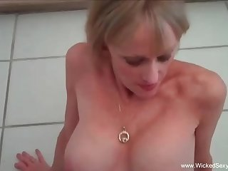 Mature platinum-blonde unsubtle with blue eyes is mildly fellating 2 knobs while say no to fucking partners are rumpus