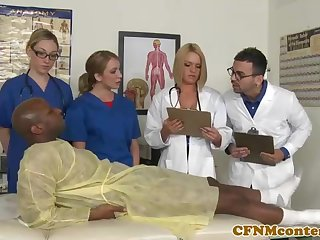 A kinky ebony patient is porking a saucy nurse who luvs to gargle unsettle firm sausages