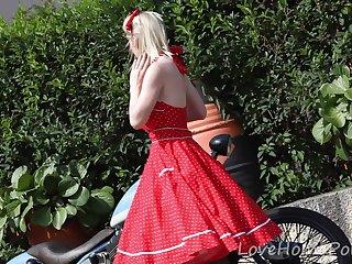 Super-Cute ash-blonde loves posing take an interest in nigh a bike