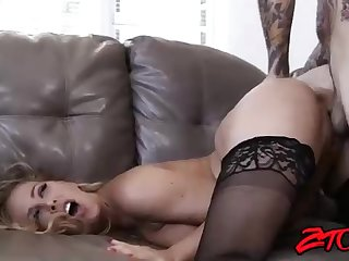 Stellar platinum-blonde cougar, Cherrie Deville is having bang-out with a tatted man, on the sofa